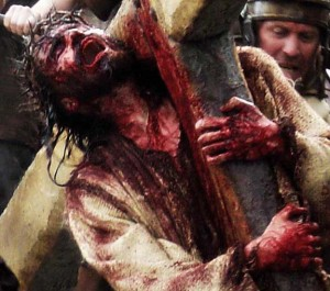 jesus-carrying-cross-bloody